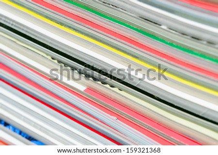 Close-up of magazine pages. Shallow DOF - stock photo