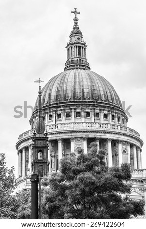 Close up of Magnificent St. Paul Cathedral in London. It sits at top of Ludgate Hill - highest point in City of London. Cathedral was built by Christopher Wren between 1675 and 1711. Black and white. - stock photo