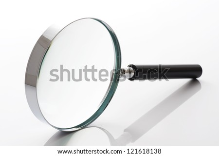 close-up of magnifying glass on gray background