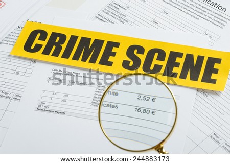 Close-up Of Magnifying Glass Over Documents With Crime Scene Yellow Tape