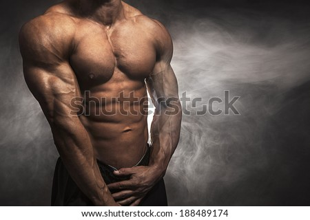 Close-up of male athlete with muscular body - stock photo