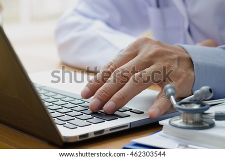 Close up of male doctor with laptop computer, electronic health records EHRs, electronic medical records system EMRs, telemedicine concept.