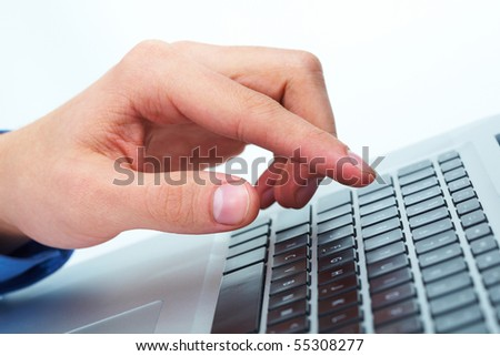 Close-up of male hand before touching button of black computer keyboard - stock photo