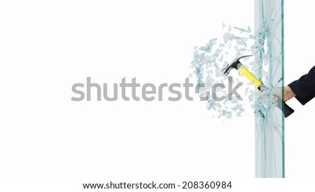 Close up of male hand breaking glass with hammer - stock photo