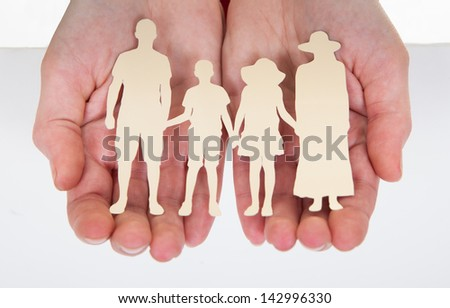 Close-up Of Male Hand Holding  Family Cutout Shape