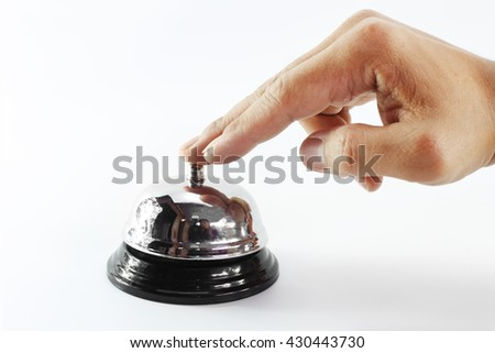 Close up of male hand pressing a service bell isolated on white background.