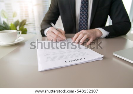 Close up of male hand putting signature in contract, businessman signing document. Successful negotiation concept, agreeing to terms, bound by contract, intend to enter in agreement, feeling confident