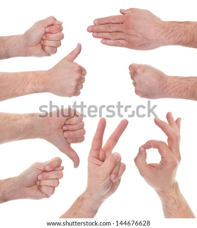 Close-up Of Male Hand Showing Various Signs Over White Background - stock photo