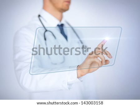 close up of male hand touching virtual screen - stock photo