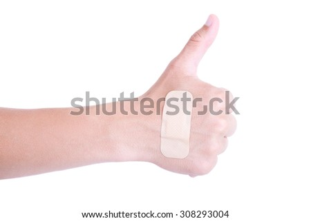 close up of male hand with adhesive plaster thumbs up isolated on white background - stock photo