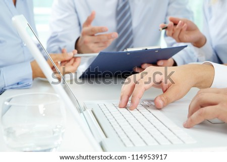 Close-up of male hands typing on the laptop keyboard