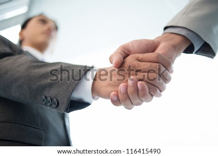 Close-up of male handshake - stock photo