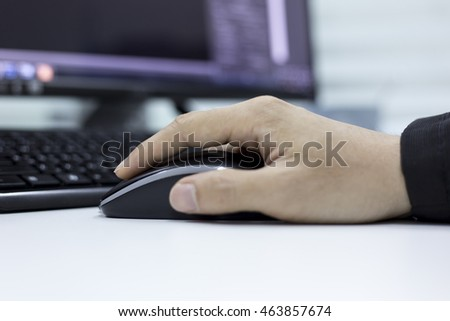Close-up of male manager working on computer