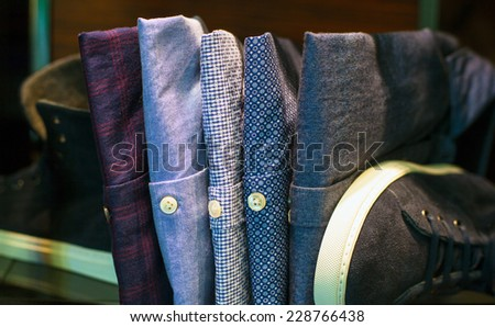 Close up of male shirts in the clothes shop - stock photo