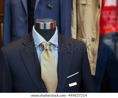 Close up of male suit exposed in the clothes shop