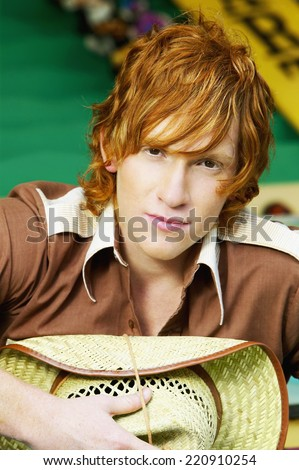 Close up of male teenager with straw hat - stock photo