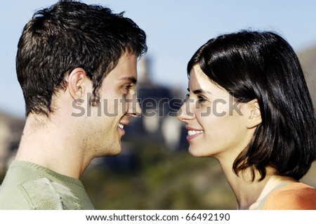 Close-up of man and woman looking each other - stock photo