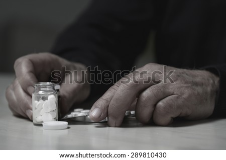 Close-up of man going to overdose drugs - stock photo