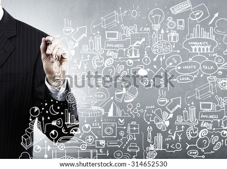 Close up of man hand drawing success strategy plan  - stock photo