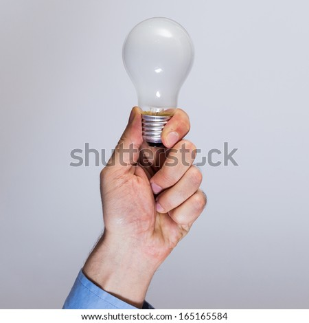 Close up of man hand with light bulb