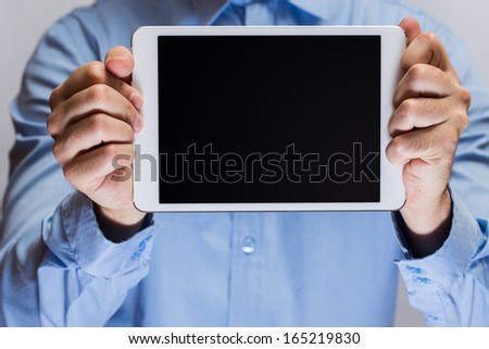 Close up of man hands holding white tablet pc - stock photo