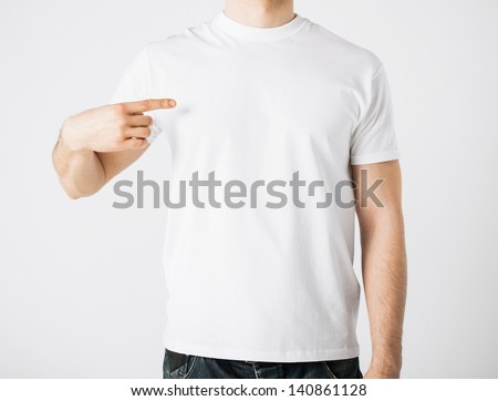 close up of man in blank t-shirt pointing at himself - stock photo