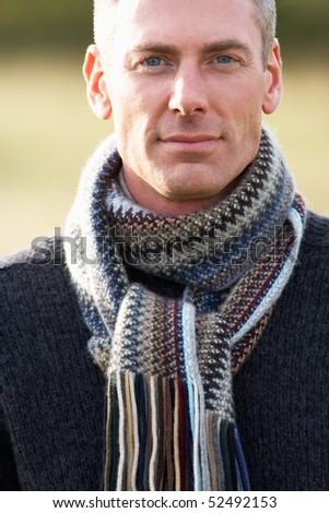 Close Up Of Man Outdoors Walking In Autumn Landscape - stock photo