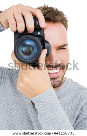 Close-up of man photographing with camera on white background