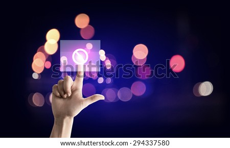 Close up of man push a stop button on touch screen