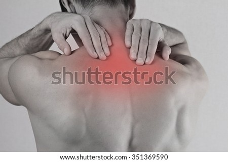 Close up of man rubbing his painful back. Pain relief concept - stock photo