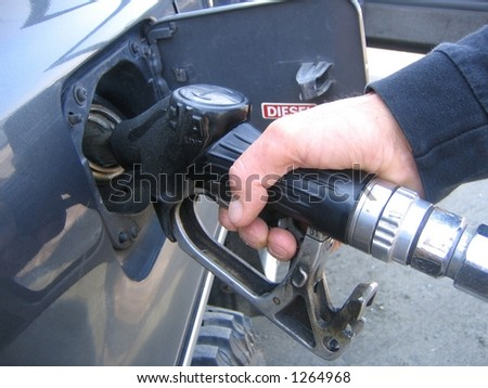 Close up of man's hand filling diesel on his car