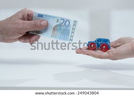 Close-up of man's hand holding the car fee - stock photo