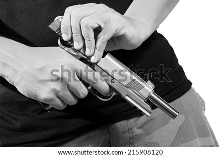 Close up of man's hand reloading gun, Man hold and loading ammunition his pistol on white background. Army, Semi-automatic handgun, 45 pistol, Black&White. - stock photo