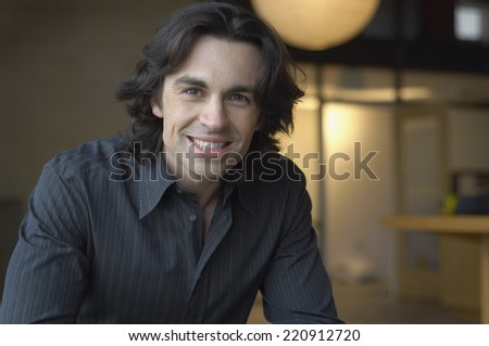 Close up of man smiling - stock photo