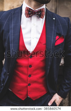 Close up of man torso, vest, bowtie and jacket, Street style, fashion blogger,