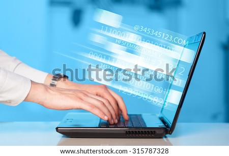 Close up of man typing on laptop computer with glowing technology effect