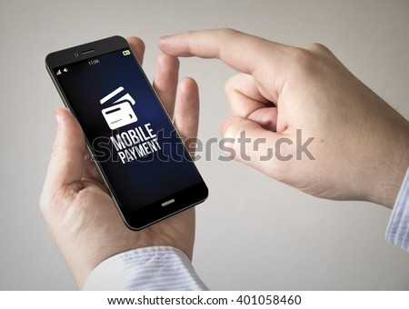 Close up of man using 3d generated mobile smart phone with mobile payment on the screen. Screen graphics are made up.