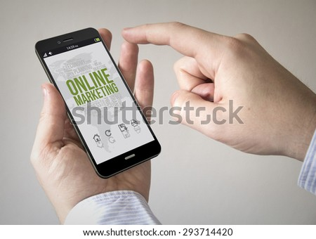 Close up of man using 3d generated mobile smart phone with online marketing on the screen. Screen graphics are made up. - stock photo