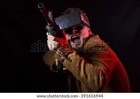Close-up of man using vr glasses and weapon gun