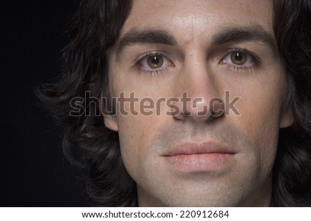 Close up of man with curly hair - stock photo