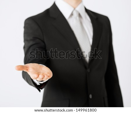 close up of mans hand showing something - stock photo
