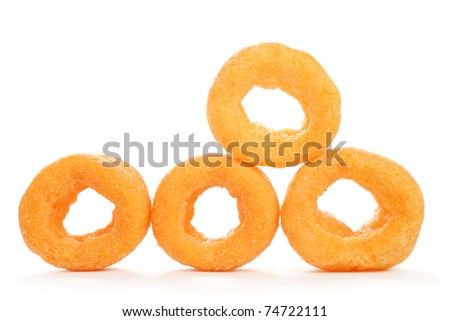 Close up of many cheesy rings isolated on white background.