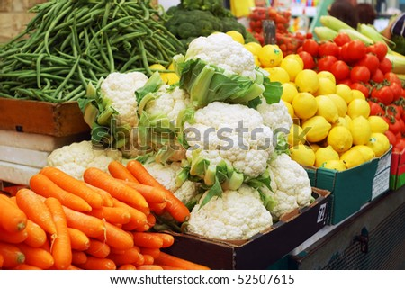 close up of many colorful vegetables on market stand - stock photo