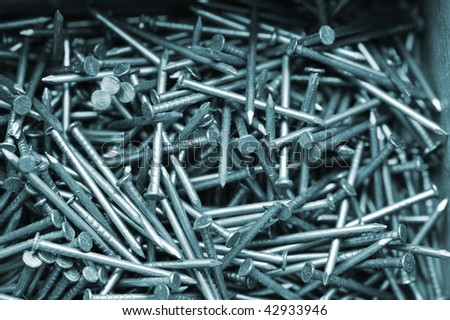 Close up of many metal nails in box