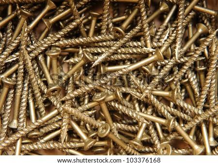 Close-up of many Torx-head wood screws - stock photo