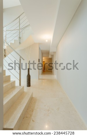 Close-up of marble stairs with bright interior - stock photo