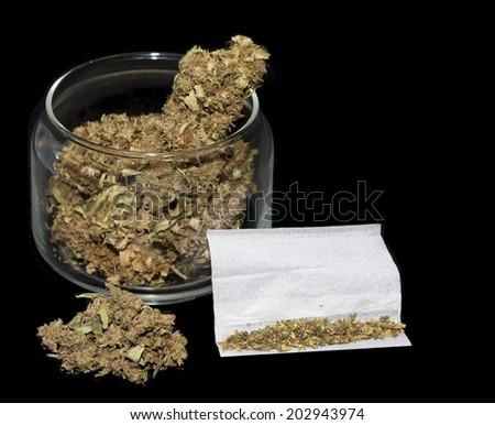 close up of marijuana cigarettes and cannabis - stock photo