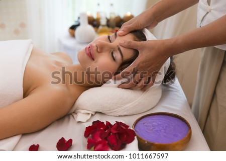 close up of masseur hand which rejuvenating and doing massage on female shoulder in the beauty  center of salon