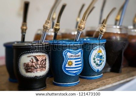 Close up of mate cups with Uruguay flag. Mate is a traditional drink very similar to tea in Argentina, Uruguay, Paraguay and some parts of Brazil. - stock photo