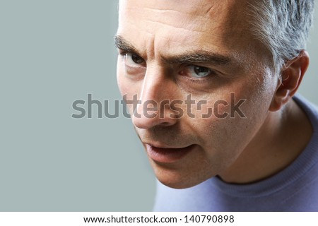 Close up of mature man on grey background
